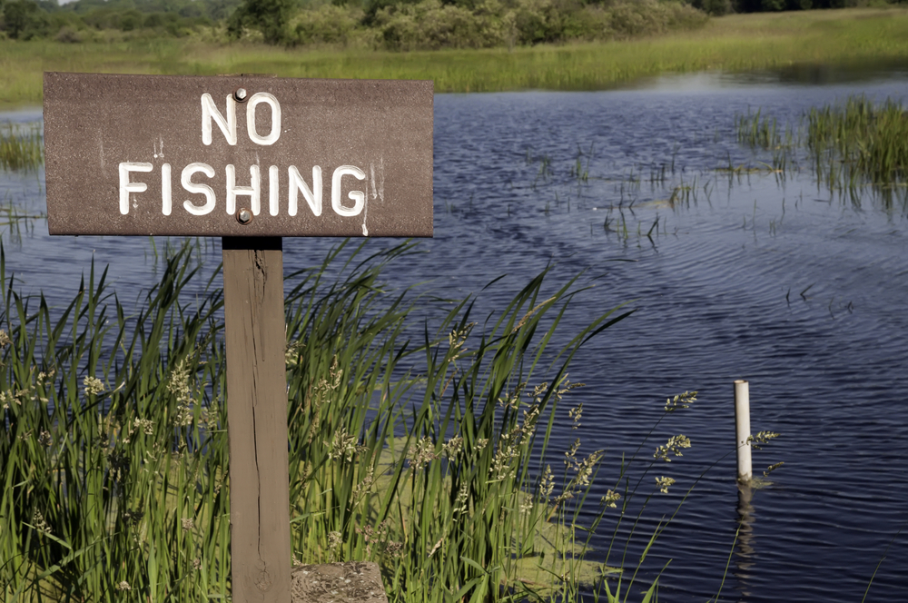 Warning sign by pond in Illinois state park